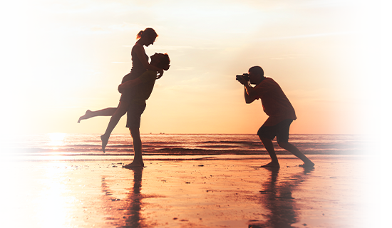 Engaged couple on the beach